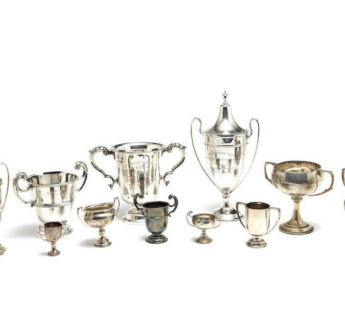 Eleven silver trophy cups