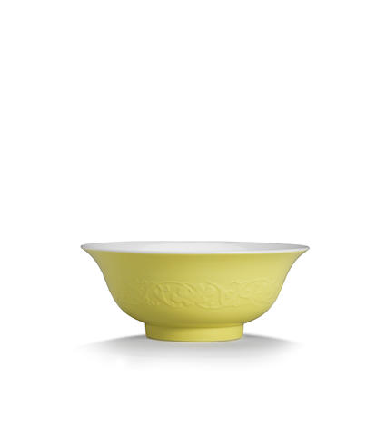 A very rare moulded lemon-yellow and famille rose bowl