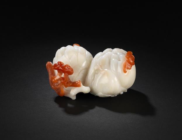 A rare carnelian agate 'double peony blossom' carving