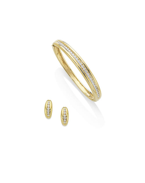 A diamond bangle and earring suite