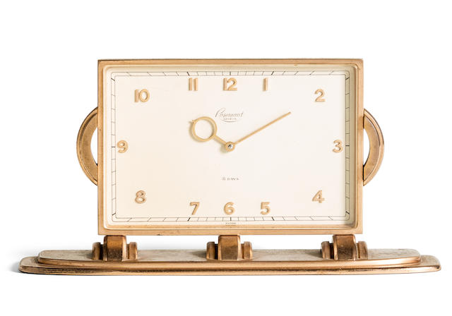 ROSEMONT. A GILT BRASS MANUAL WIND TABLE CLOCK WITH 8 DAY POWER RESERVE