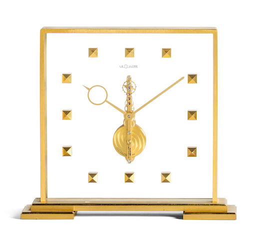 JAEGER-LECOULTRE. A BRASS SKELETONISED TABLE CLOCK WITH 8 DAY POWER RESERVE