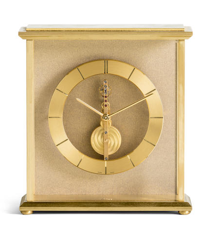 Jaeger-LeCoultre. A brass skeletonised table clock