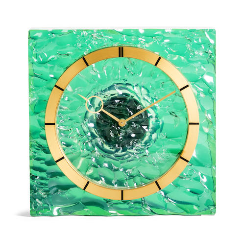 Jaeger-LeCoultre. A fine brass and green acrylic table clock