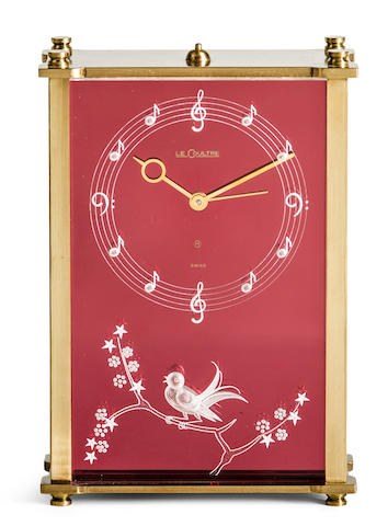 Jaeger-LeCoultre. A brass musical alarm buzzer clock decorated with bird on plum tree, 8 day power reserve