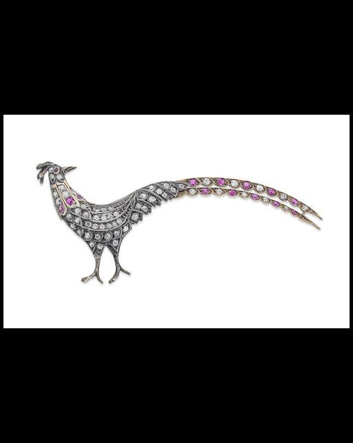 A ruby and diamond ornamental pheasant brooch