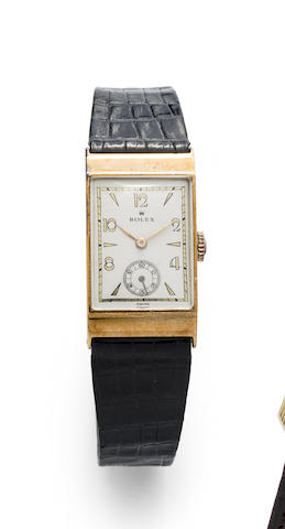 Rolex. A 9K gold manual wind wristwatch