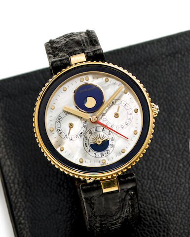 Gerald Genta. An 18K gold and mother-of-pearl quartz calendar, moonphase and alarm wristwatch with box and papers
