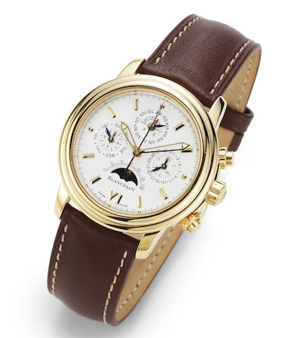Blancpain. A fine 18K gold automatic perpetual calendar chronograph wristwatch with moon phase with box and paper