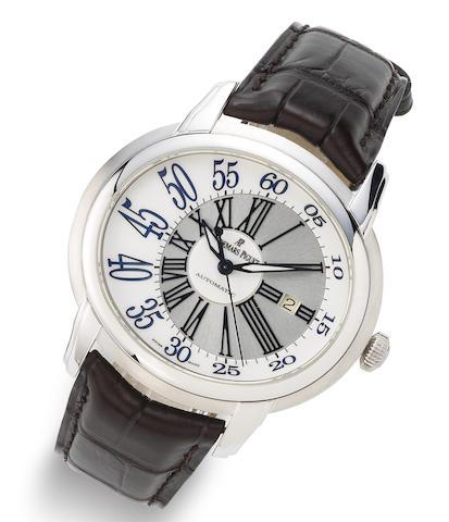 Audemars Piguet. An 18K white gold automatic calendar wristwatch