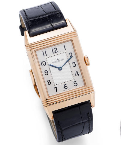 Jaeger-LeCoultre. A fine 18K rose gold manual wind reversible wristwatch with box and papers