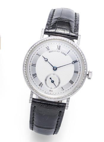 Breguet. A fine 18K white gold and diamond set manual wind wristwatch