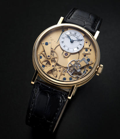 Breguet. An 18K gold manual wind skeletonised wristwatch with power reserve indication