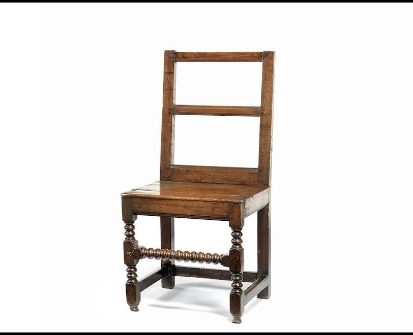 A late 17th century oak back stool