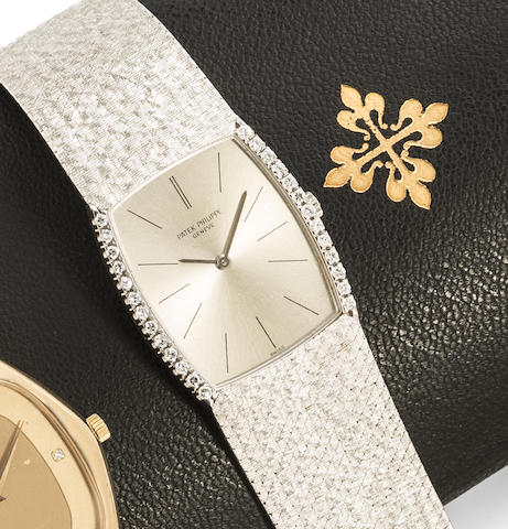 Patek Philippe. An 18K white gold and diamond set manual wind bracelet watch with box and paper