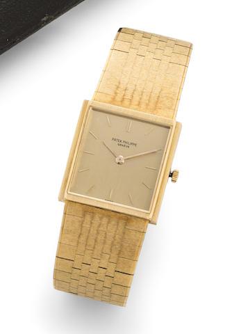 Patek Philippe. An 18K gold manual wind bracelet watch