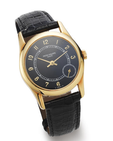 Patek Philippe. An 18K gold automatic wristwatch together with Extract from the Archives