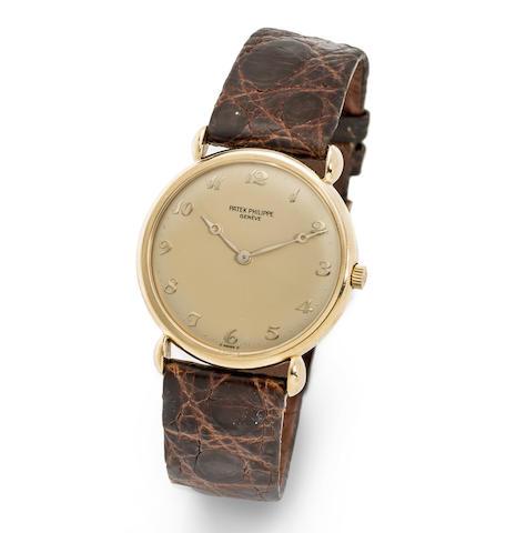 Patek Philippe. An 18K gold manual wind wristwatch
