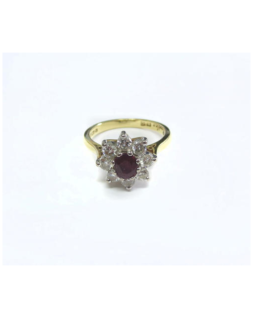 An 18ct gold ruby and diamond cluster ring, by Boodles