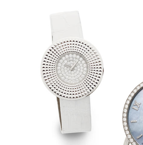 Piaget. A lady's 18K white gold and diamond set quartz wristwatch with box and papers
