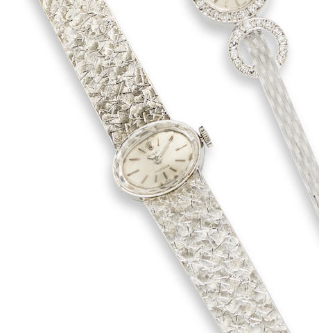 Rolex. A lady's 18K white gold manual wind bracelet watch