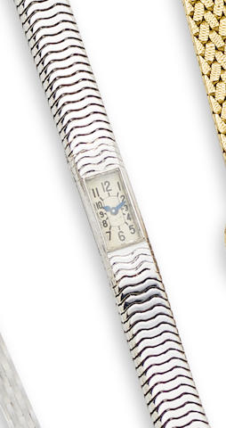 European Watch Co. A platinum manual wind 'snake' bracelet watch