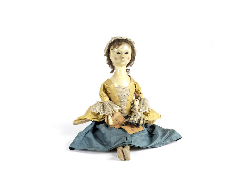 An important English wooden doll and her contemporary smaller doll