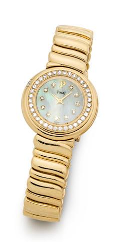 Piaget. An 18K Gold and Diamond Set Mother-of-pearl Quartz Bracelet Watch