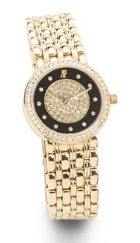 Audemars Piguet. An 18K gold and diamond set manual wind bracelet watch