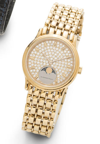 Audemars Piguet. An 18K gold and diamond set manual wind bracelet watch with moon phase