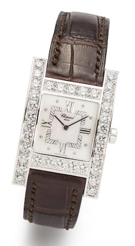 Chopard. An 18K white gold, diamond set and mother-of-pearl quartz wristwatch