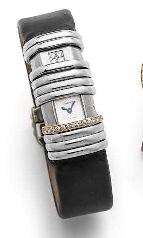 Cartier. A lady's titanium, 18K white gold and diamond set wristwatch