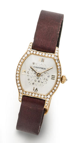 Cartier. An 18K gold mother of pearl and diamond set quartz wristwatch