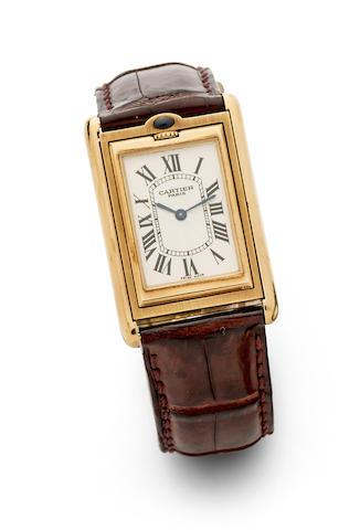 Cartier. An 18K gold manual wind reversible wristwatch