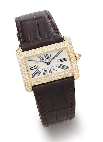 Cartier. An 18K Gold and Diamond Set Quartz Wristwatch