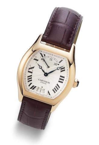 Cartier. An 18K rose gold manual wind calendar wristwatch