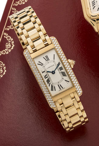 Cartier. A lady's 18K gold and diamond set quartz bracelet watch with box and papers