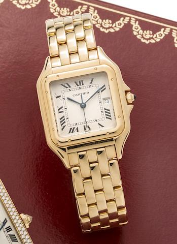 Cartier. An 18K gold quartz calendar bracelet watch