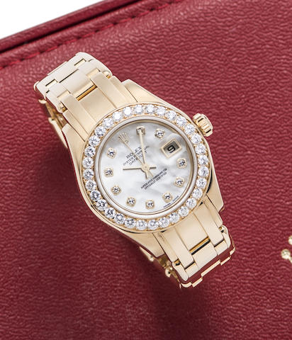 Rolex. A lady's 18K gold, diamond set and mother of pearl automatic calendar bracelet watch