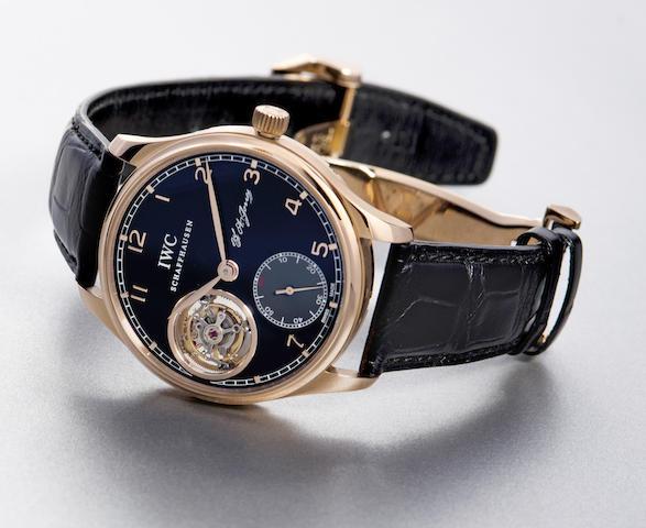 IWC. An 18K rose gold manual wind tourbillon wristwatch