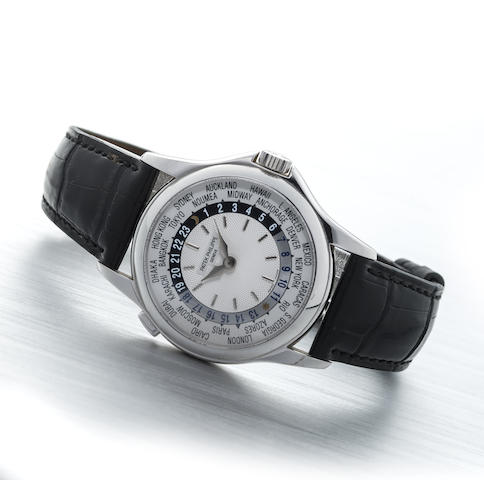 Patek Philippe. A fine 18K white gold automatic world time wristwatch with box and papers