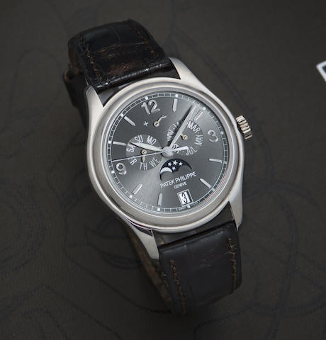 Patek Philippe. An 18K white gold automatic annual calendar wristwatch with box and papers