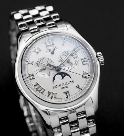 Patek Philippe. A fine and rare 18K white gold automatic annual calendar moon phase bracelet watch with Certificate of Origin