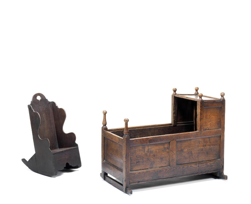 An early 19th century oak cradle together with a 19th century oak child's rocking chair