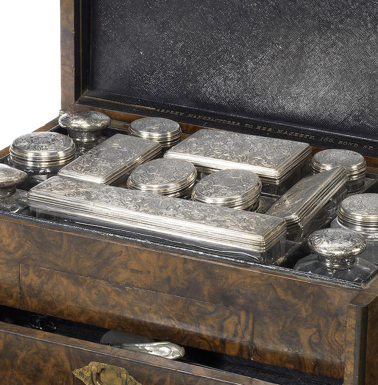 A Victorian walnut and brass bound ladies toilette case
