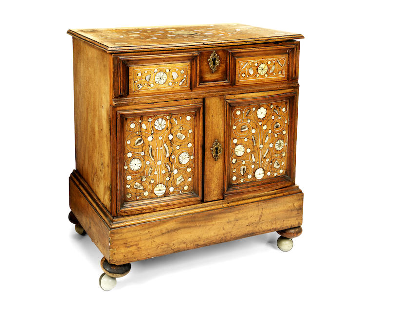 A small Indo-Portuguese 18th century walnut, ivory and mother of pearl inlaid table top cabinet