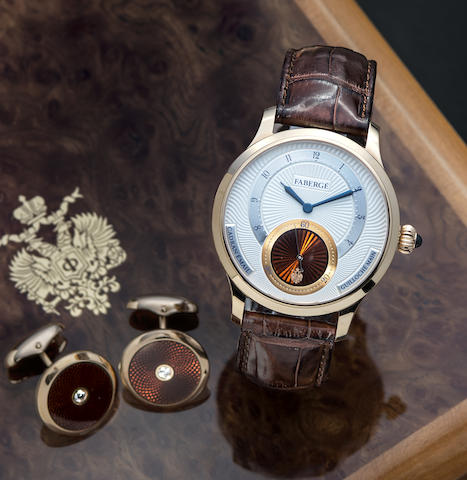 Fabergé. An 18K rose gold enamel and guilloché engraved manual wind wristwatch and cufflink set with box and papers