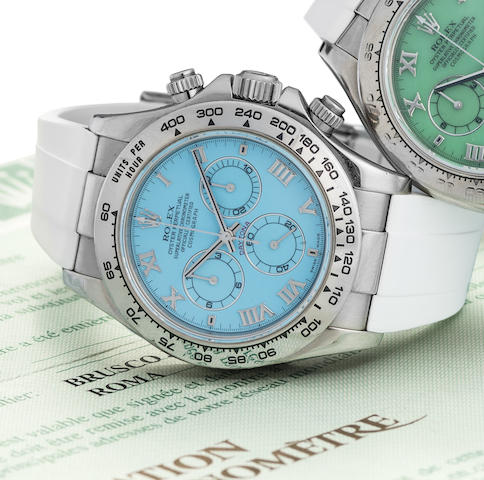 Rolex. An unusual 18K white gold and turquoise dial automatic chronograph wristwatch with box and paper