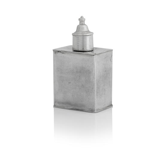 A miniature silver tea caddy