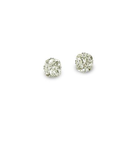 A pair of diamond single-stone earrings